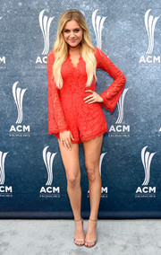 Kelsea Ballerini wore gold ankle-strap sandals with her romper for added elegance.