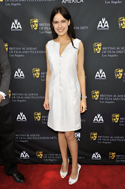 Sophie Winkleman teamed her white dress with a pair of white peep-toe slingbacks.