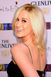 Kellie Picker was all smiles on the red carpet with platinum blond tresses that were accented by a subtle side part.