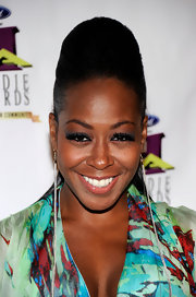 That sky-high pompadour Tichina Arnold wore at the Ford Hoodie Awards was a real attention-grabber.