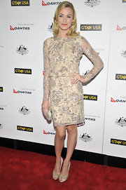 Yvonne paired her glitzy dress with metallic peep-toe pumps.