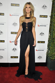 Delta Goodrem heated up the G'Day USA red carpet in a sheer-panel black evening dress with a thigh-high slit.