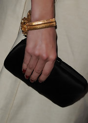 Amber Heard wore a handwired Russian gold plated floral cuff adorned with crystals and glass pearls.
