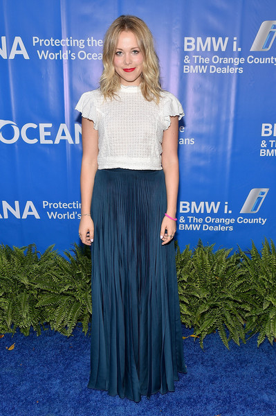 Poppy Jamie paired her blouse with a pleated blue maxi skirt.