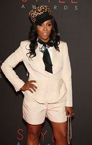 June Ambrose styled her all-white shorts suit with a leopard print cap.