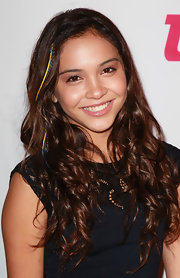 Stella Hudgens accented her brown curls with a multicolor braid.