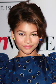 Zendaya looked mature and elegant with this gorgeous side-swept updo at the 'Teen Vogue' party.