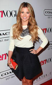 Amber Lancaster opted for a fun and flirty ensemble at the 'Teen Vogue' soiree. She donned a white sweater with lace detailing paired with a black full skirt with a banded waist.