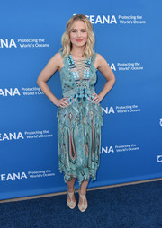 Kristen Bell finished off her outfit with white T-strap peep-toes by Christian Louboutin.