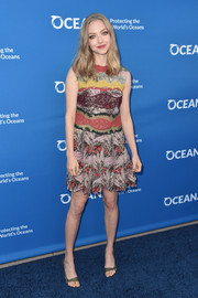 Amanda Seyfried pulled her colorful look together with a pair of olive-green sandals.
