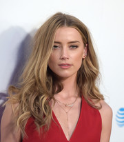 Amber Heard wore her hair down in messy waves during the 'Adderall Diaries' premiere.