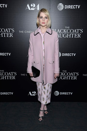 Lucy Boynton attended a screening of 'The Blackcoat's Daughter' wearing a dusty-pink wool coat by Prada.