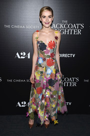 Kiernan Shipka was an absolute delight to the eyes in this colorful flower-appliqued gown by Rosie Assoulin at the screening of 'The Blackcoat's Daughter.'