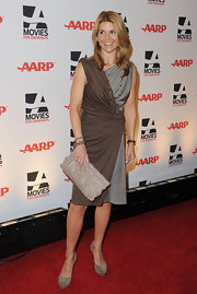 Lori Loughlin complemented her two-toned dress with taupe sudede platform pumps.