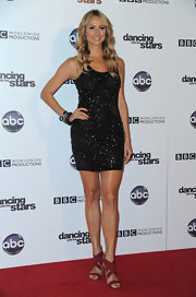 Stacy Kiebler sported red strappy heels on the red carpet. The shoes were an interesting choice for her black sparkling mini dress.