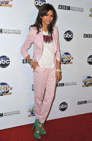 Zendaya rocked a pale pink pantsuit for a cool blend of masculine and feminine styles on the red carpet.