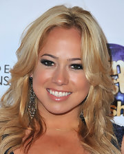 Sabrina Bryan chose a layered wavy style to show off her blonde locks.