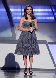 Martina McBride balanced her the girly vibe of her lacy frock with sultry blue metallic strappy platforms.