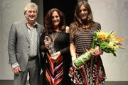 Vittorio Missoni, Angela Missoni and Margherita Missoni pose for a photograph after accepting an award on the catwalk after their show during Audi Fashion Festival Singapore 2011 at Tent@Orchard on May 13, 2011 in Singapore.