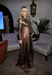 Molly Sims showed off her festive maternity style with this bronze maxi dress at the AFI closing night screening of 'Patriot's Day.'