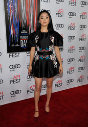 Lana Condor amped up the girly vibe with a pair of red Mary Janes.