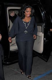 Oprah Winfrey wore an ultra-chic draped gray blouse with glittery embellishments to the screening of 'Precious.'