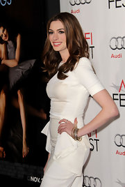 Anne Hathaway paired her Antonio Berardi dress with sparkling gold and silver bangle bracelets.