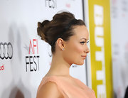 Olivia Wilde wore her hair in a sweet knotted updo accented by a thin leather headband at AFI FEST 2011.
