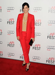Julia Ormond brought pop to the red carpet screening of 'My Weekend With Marilyn' in a red wool suit with cropped pants.