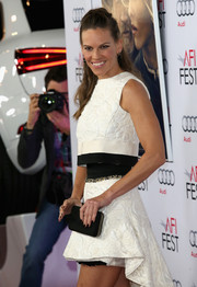 Hilary Swank paired a black Christian Louboutin satin clutch with a crop-top/mini skirt combo for the screening of 'The Homesman.'