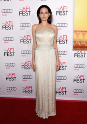 Angelina Jolie was pure elegance in a Swarovski crystal-embellished strapless gown by Atelier Versace at the AFI Fest opening night premiere of 'By the Sea.'