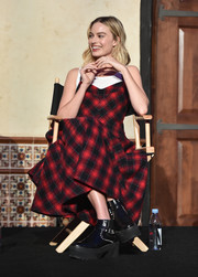 Margot Robbie went edgy with these studded platform boots by Louis Vuitton at the AFI FEST Indie Contenders Roundtable.