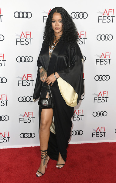 Rihanna paired her coat with black lace-up heels by Manolo Blahnik.