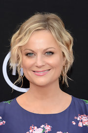 Amy Poehler pinned back her beachy waves into an undone updo for a cool and casual look at the AFI Life Achievement Gala.