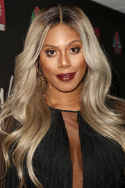 Laverne Cox showed off a perfect wavy hairstyle at the AHF World AIDS Day concert.