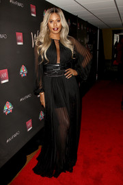 Laverne Cox went for subtle sex appeal in a sheer black Grecian gown at the AHF World AIDS Day concert.