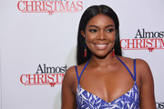 Gabrielle Union opted for a classic straight center-parted style when she attended the Atlanta screening of 'Almost Christmas.'