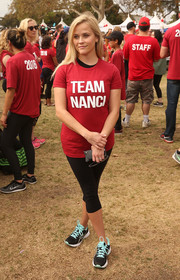 Reese Witherspoon teamed Asics running shoes with capri leggings and her 'Team Nanci' T-shirt for the Walk to Defeat ALS.