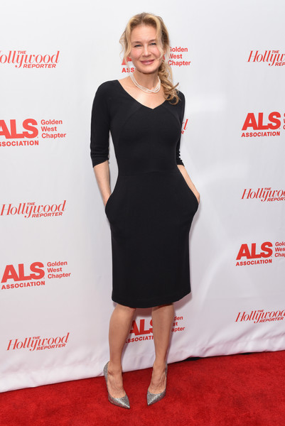 Renee Zellweger cut a sleek and elegant figure in a fitted LBD with a wide V neck and 3/4 sleeves at the Champions for Care and a Cure event.