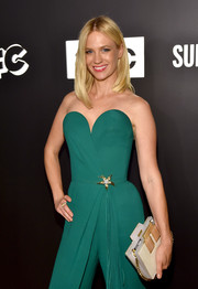 January Jones paired a two-tone box clutch with a strapless green jumpsuit for the Emmy afterparty.