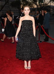 Kiernan Shipka chose sweet-looking silver ankle-strap sandals by Miu Miu to complement her dress.