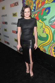 Elisabeth Moss styled her top with a fierce black leather skirt by Alexander McQueen, featuring an up-to-there slit.