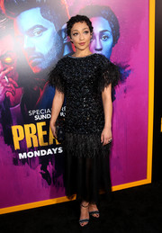 Ruth Negga continued the razzle-dazzle with a pair of bejeweled black sandals by Giuseppe Zanotti.