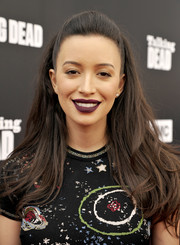 Christian Serratos opted for a classic half-up hairstyle when she attended the Talking Dead Live event.