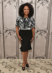 Lynn Whitfield paired her top with a curvy black ruffle-hem skirt.