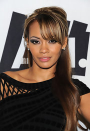 Evelyn Lozanda wore her honey highlighted locks up in a half up hairstyle.