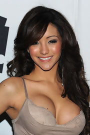 Melanie Iglesias showed off voluminous curls at the AOL 'Maxim' party. She added a little volume to her roots for extra height.