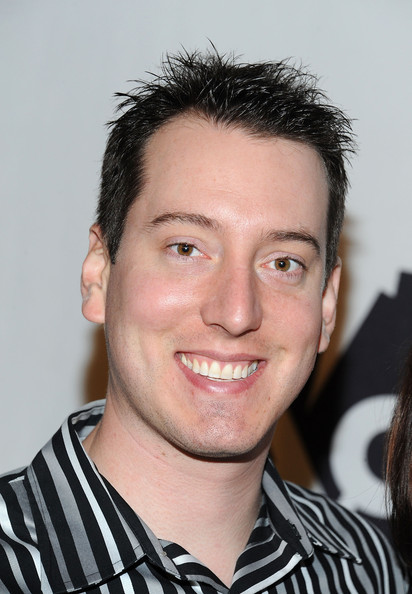 Kyle Busch's spiked hair spiced up his striped shirt and black pant combo.