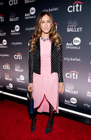 Sarah Jessica Parker layered a studded black Saint Laurent leather jacket over a pink fishtail dress for the 'city.ballet' premiere.
