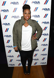 Amber's skinny leather leggings were balanced out by her green utility jacket.